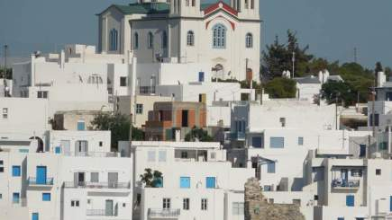 Greek hillside full of white buildings