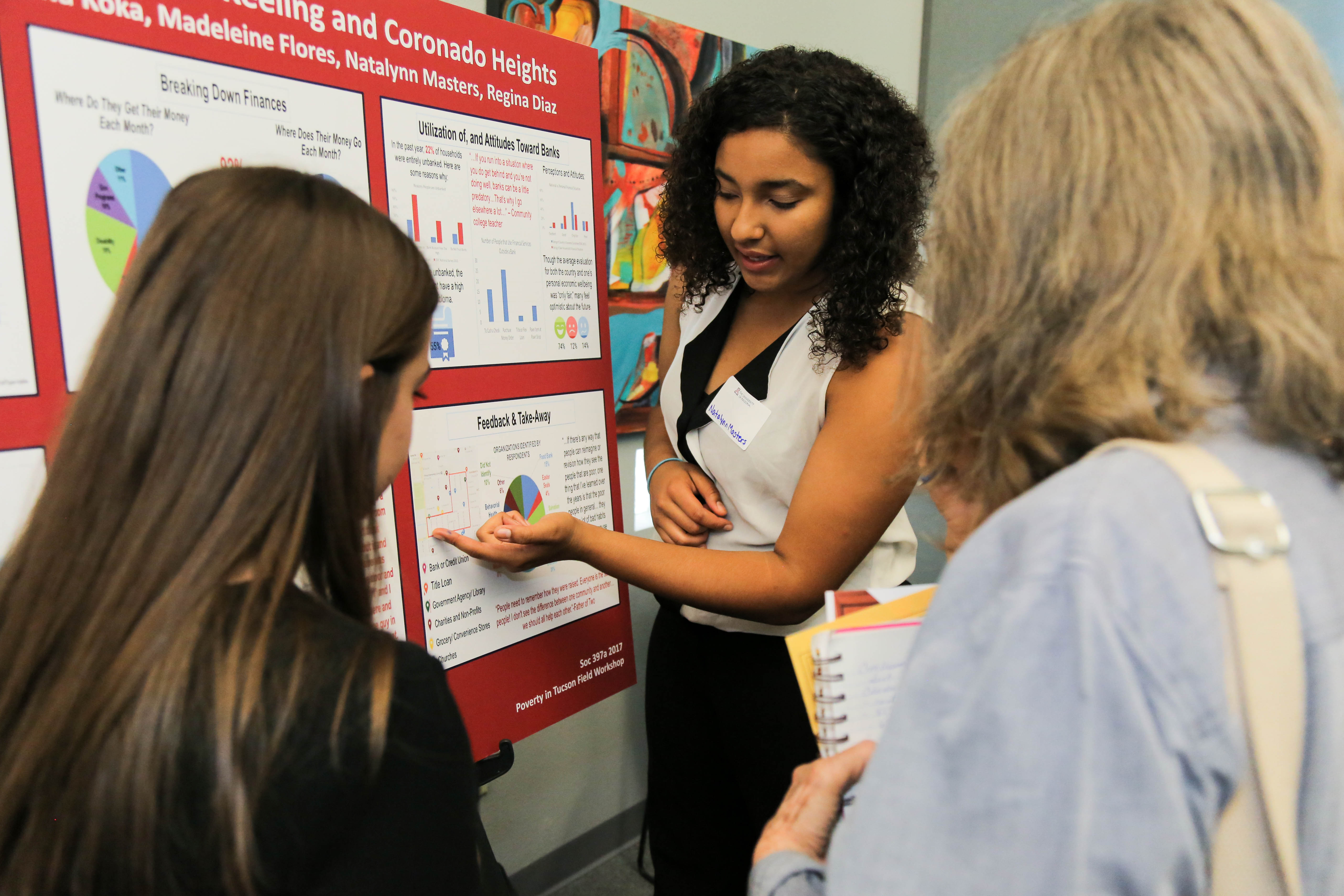 Student presenting poster at annual Tucson Poverty Forum