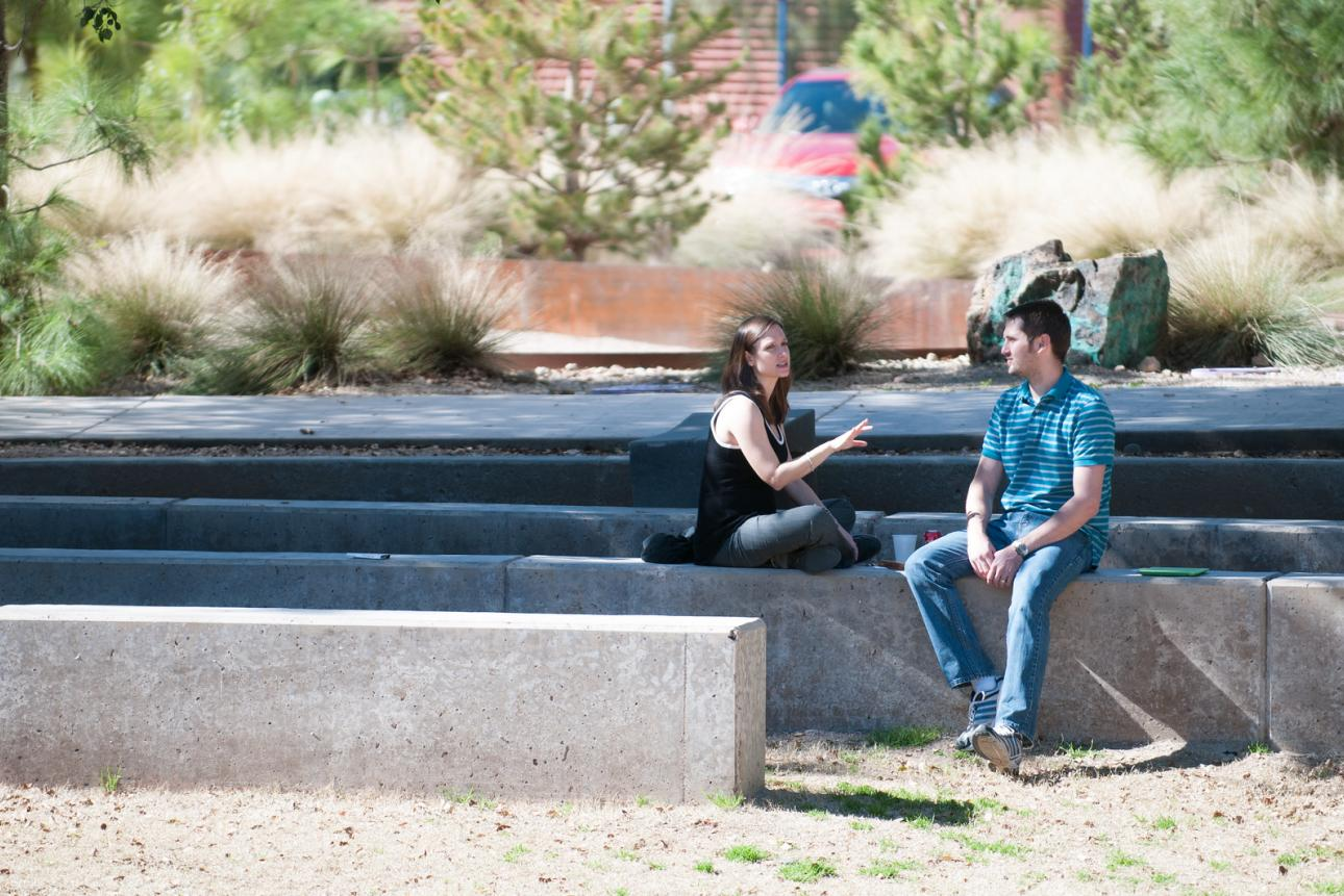Two students talking outdoors on campus