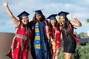 Four female American Indian Studies students at graduation