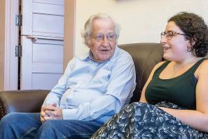 Student sitting with UA Professor Noam Chomsky